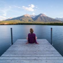 Lady sitting on a dock