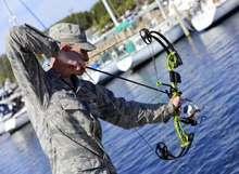 Man holding bow fishing kit